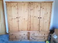 FOR SALE an extra large 4 door and 4 drawer solid wood wardrobe.