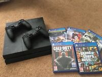PlayStation 4 with 5 games, 2 controllers