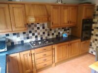 Solid oak kitchen with Neff gas hob,hotpoint oven and kenwood dishwash