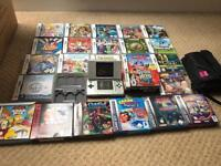 Original silver Nintendo DS with 24 games, carry case and game case