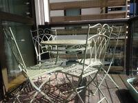 Sage Green Metal Garden Furniture Set: Table & 4 matching chairs.