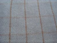 Length of beige sewing material