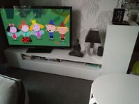 Large white gloss TV unit. Solid bit of furniture, very heavy.