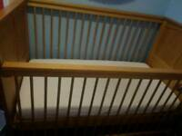 Trama cot bed with matters and fitted sheets.