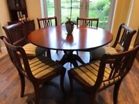 Extendable mahogany dining table with 6 chairs. Immaculate condition.