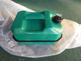 Immaculate Rhino metal spare 10 ltr fuel container and plastic spout.