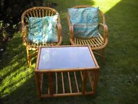 2 BAMBOO CHAIRS WITH CUSHIONS 30X28X24 & A GLASS TOP BAMBOO TABLE 25X20X18 INCHES