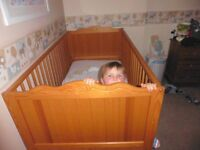 Lovely solid pine cot that can be converted into a small bed for up to 6 year olds