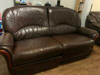 BROWN LEATHER RECLINING TWO SEATER AND ARM CHAIR