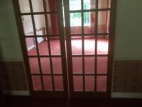 Oak sliding glass panelled doors.