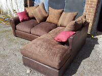 Good looking BRAND NEW brown corner sofa with lovely cushions. In the Box. Can deliver