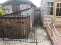 Pair of metal gates and single with hasp and staplr for padlock