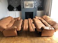 Leather three seater reclining sofa
