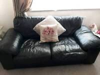 2 + 3 seater black leather sofas