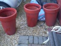 3 large red plant pots