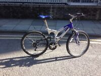 "Mountain Bike for sale (Brand: Rhino). In working condition. 15 gears, 26"" wheels & with suspension"