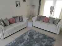 2x white leather chesterfield sofas 1 has never been sat on other as new