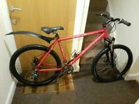 Carrera Vulcan mountain bike with 26 wheel size and 20 inch frame size.