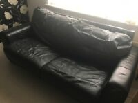 Large 2 seater black leather sofa bed - FREE