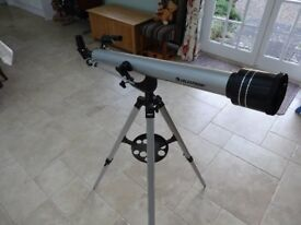 Celestron telescope with tripod stand, instructions, additional lenses. A great present