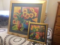 Matching golden framed designer prints