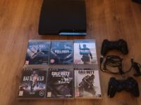 Sony PS3 slim. 2x controllers 1x headset and 6x Games
