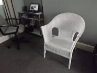 Large white wicker chair.