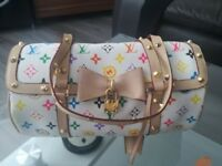 Hi!I got lovely bag from Louis Vuitton multicolour white very good condition