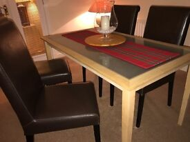 White oak dining table with frosted glass insert.