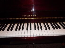 upright piano by hyundia ---showroom condition--