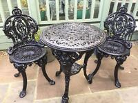 Cast iron table and 2 cast iron chairs
