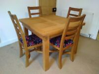 Extendable solid oak dining table and 4 chairs