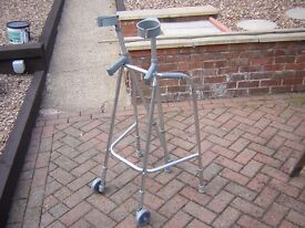 WALKING ZIMMER FRAME AND CRUTCHES.