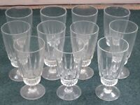 Set of eleven tall glasses, can be used for wine, soft drinks, or as Sundae dishes for desserts
