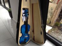 Blue violin, carry case and accessories. Suitable for children to learn on. Exceptional condition.