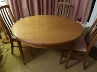 G-Plan Dining Table , circular, extends to an oval, and 4 matching chairs, good condtion