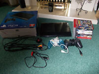 PS3 Console, 2 controllers and 7 Games