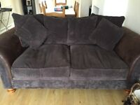 Four seater and three seater brown sofas