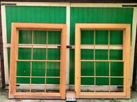 Two large wooden sash windows