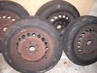 FREE TO COLLECT. 4 PLAIN BLACK WHEELS AND TYRES FROM V.W GOLF 2004 1.6 SOME TREAD LEFT