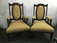 A pair of vintage chairs with new fabric