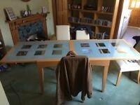 Extendable wood and glass dining table and four chairs
