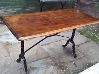 Garden / patio table with wooden top and cast iron legs