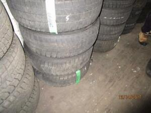 SET OF 4 USED 235/65R17 BRIDGESTONE WINTER TIRES ON MULTIFIT RIMS