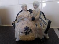 2 blue and white style victorian figures