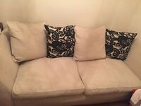 modern large sofa very wide and comfy.. With large duck feather pillows in a cream and black colour
