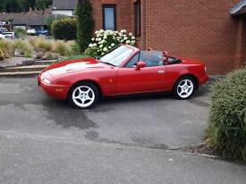 Mazda MX5 - An elegant Red sporty car, which has been very well looked after.