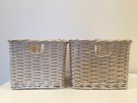 Two white storage baskets