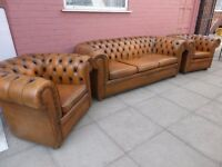 A Tanny/Gold Leather Chesterfield Three Piece Suite