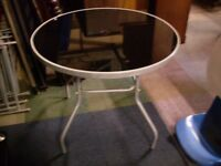 Round glass topped garden table / outdoor table and 4 folding chairs